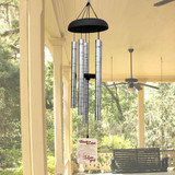 Wind chimes printed with the chimes of love poem.