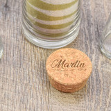 Cork stopper is engraved with last name