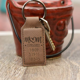 Personalized keychain for mom in dark brown features children's birthdates