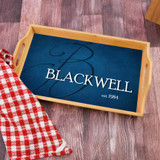 Personalized bamboo serving tray has family last name and established year along with initial.