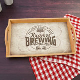 Personalized serving tray has the family last name and established year along inside a beer stained logo