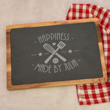 Personalized slate cutting board is rectangular and features her name.