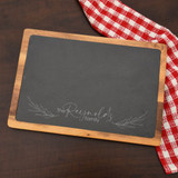 Stylish personalized cutting board has family last name at the bottom.