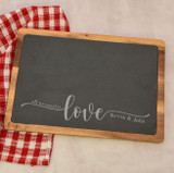 Personalized cutting board with couple's names is a unique bridal shower gift.
