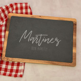 Bon Appetit Personalized cutting board has family last name engraved on the slate insert.