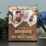 "Personalized picture frame for the adventurous family features their last name and holds a 4""x6"" picture."