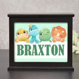 Personalized ligh box night light for children has dinosaurs and child's name.