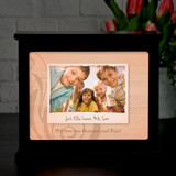 Illuminated personalized lightbox with image, caption under image and a short message.