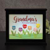Personalized light box for grandma has grandchildren's name on flowers.