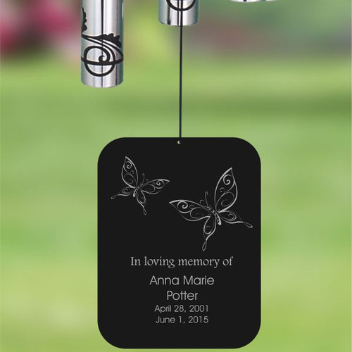 Back of wind chime is personalized with name and dates