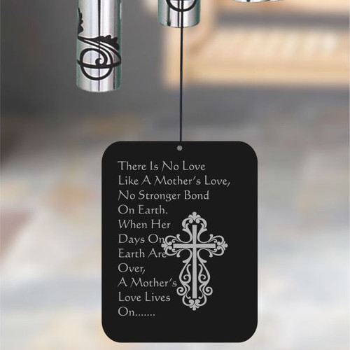 Front of wind chime sail is engraved with poem
