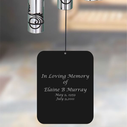 Back of wind chime sail is personalized with name and dates.