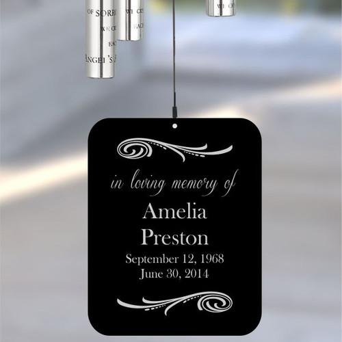 The back of the wind chime sail is engraved with name and dates