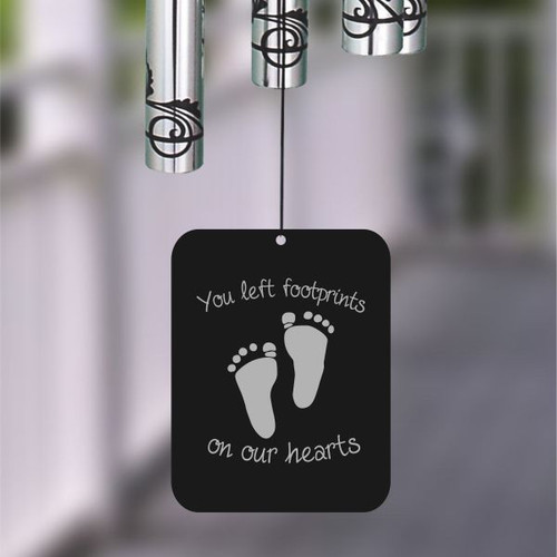 Front of wind chime sail engraved with you left footprints on our hearts