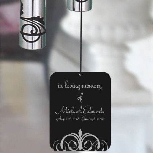 The back of memory chime wind sail personalized with name and dates