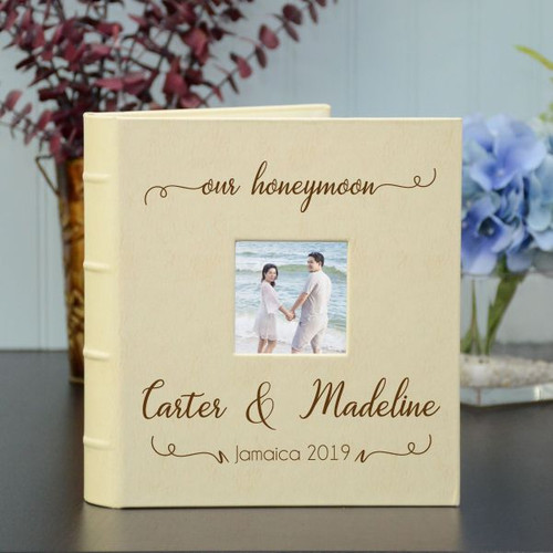Honeymoon photo album personalized with couple's names and destination