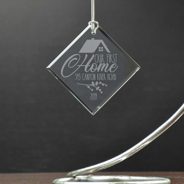 Laser engraved personalized ornament with home address.