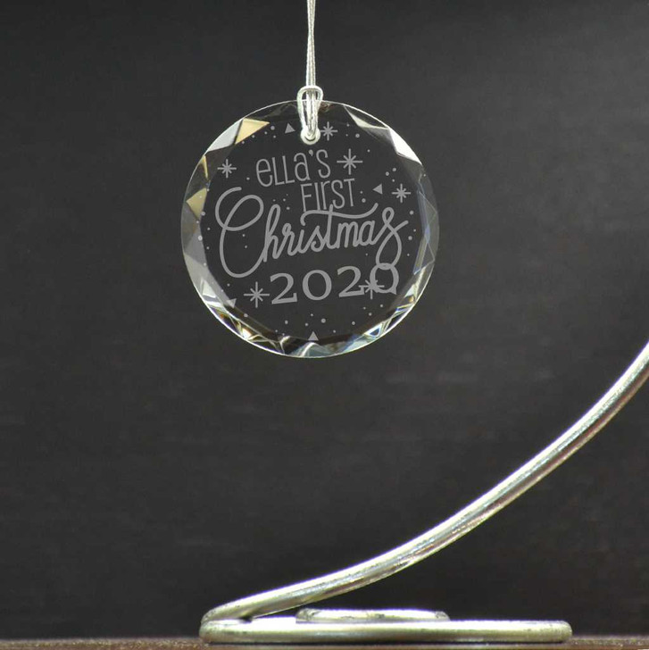 Personalized round glass ornament is a great addition to the Christmas tree for baby's first Christmas