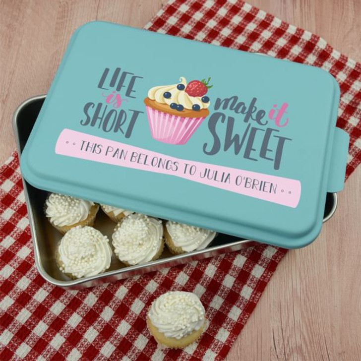 This cute personalized baking pan features the owner's name and a cupcake design printed on the lid.