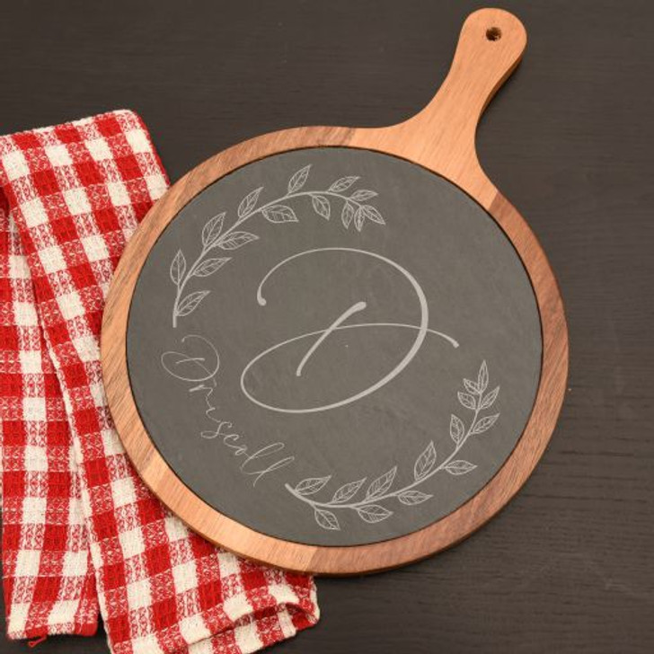 This personalized cutting board has family last name and initial