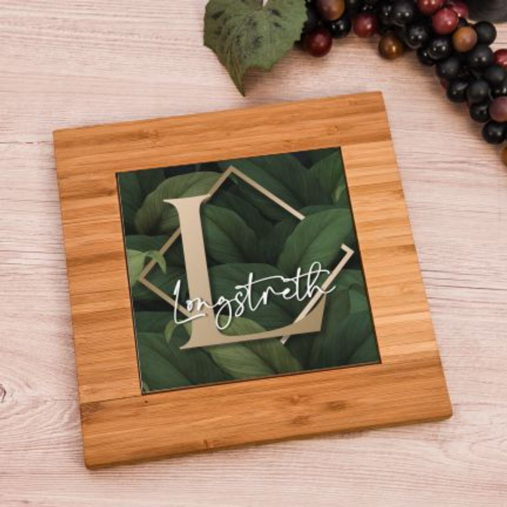 Elegant bamboo and ceramic personalized trivet features family last name and initial