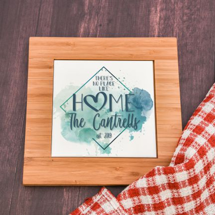 There's No Place Like Home Personalized trivet has family last name and established year.