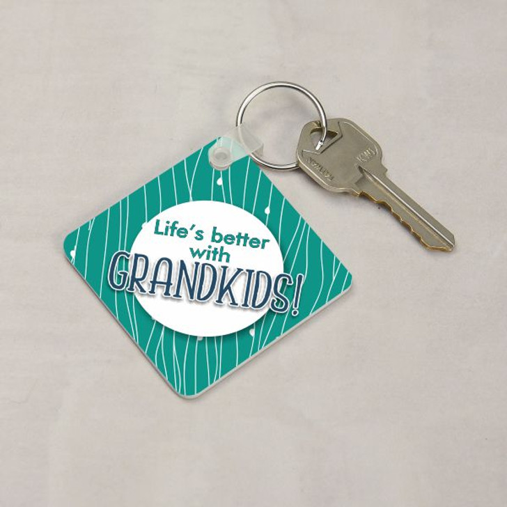 """Front of personalized keychain says """"life's better with Grandkids"""""""