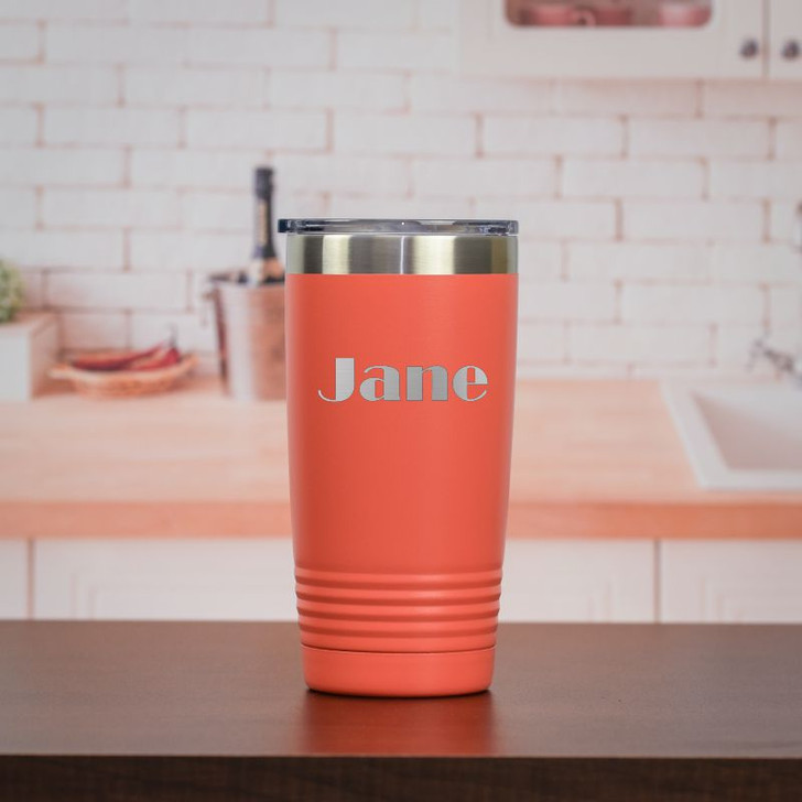Personalized 20 ounce travel mug shown in Coral.
