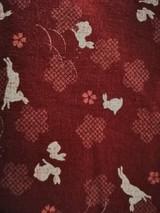 Kura Col 103 Red rabbits - per half metre length