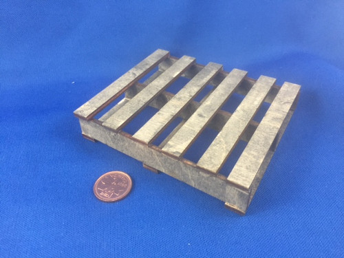 NOTE:  This is our first pallet.  It has been redesigned with more planks on top (7 instead of 6)