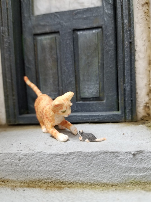 Orange Cat with Mouse