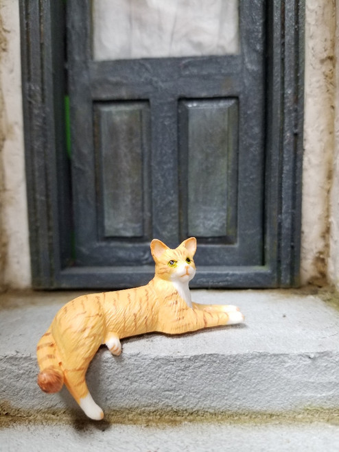 Orange Cat with Dangling Leg