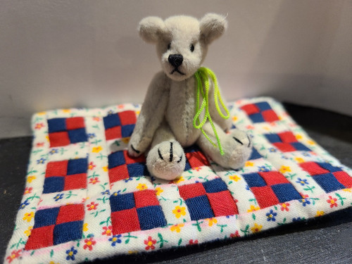 Miniature  Teddy Bear on Quilt