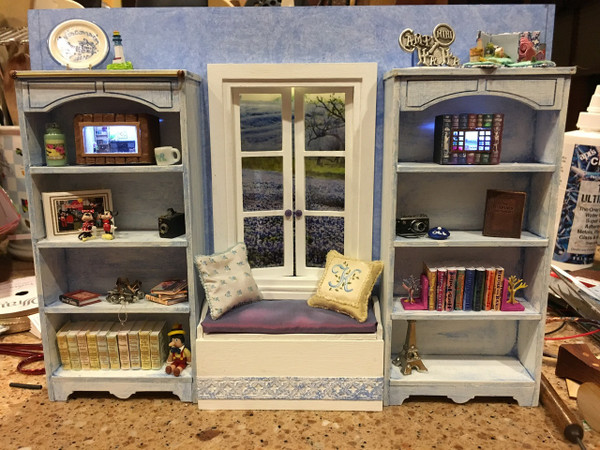 Shelf kits on either side of the window and window seat kit under the window.  Thanks Kathy Novak for sharing!  Window seat kit is made by us and listed here: http://www.grandpasdollhouse.com/blanket-box-window-seat-kit/