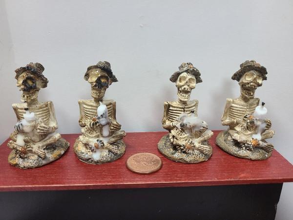 Miniature Skeleton Holding Melting Candle