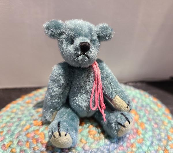 Miniature  Teddy Bear on Aqua Rug
