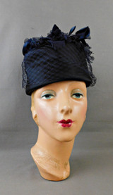 Vintage Black Satin Evening Hat with Midnight Blue Flowers and Netting 1960s, 21 inch head, Betmar