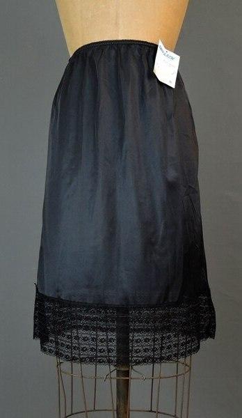 Vintage 1970s Black Nylon Snip-A-Row Half Slip, 24 to 28 waist