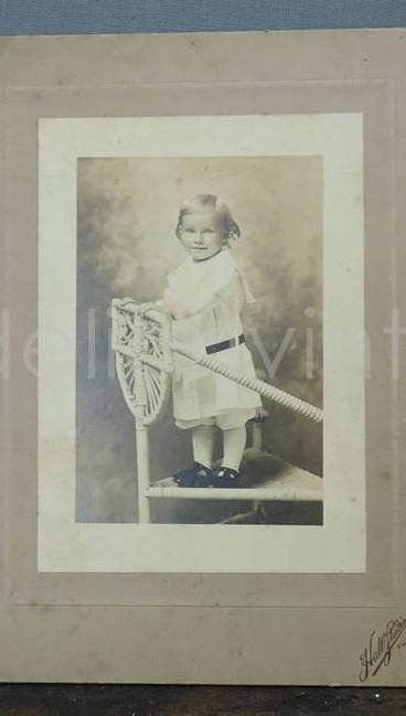 Antique Cabinet Photo, Child on Wicker Chair Edwardian 8x6 inches, early 1900s