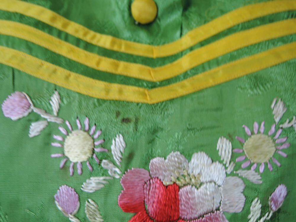 Spot above embroidery