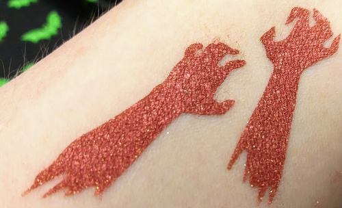 He's Got an Arm Off - red eyeshadow with gold duochrome shift and sparkle