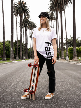 A young women with a skateboard wearing the Fast Vert t-shirt