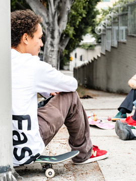 A skater takes a break while wearing the Fast Vert long sleeve t-shirt