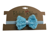"Our adorable Shabby Rose Bow flower is attached to a 5/8"" width Satin Stretch Headband.  Overall width is approximately 6"", comfortably stretches to approximately 9"".  Flower and headband match, unless otherwise requested.  Perfect for newborn through toddler."