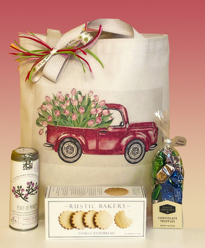 The Special Delivery gift basket combines floral delivery with artisan tea and snacks.  A perfect way to send celebrate Mother's Day, send get well wishes, or just thinking of you.