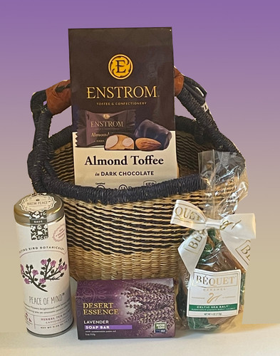 Artisan sweets, tea and luxury soap tucked inside a hand-crafted African basket.  The perfect hostess or thank you gift basket.