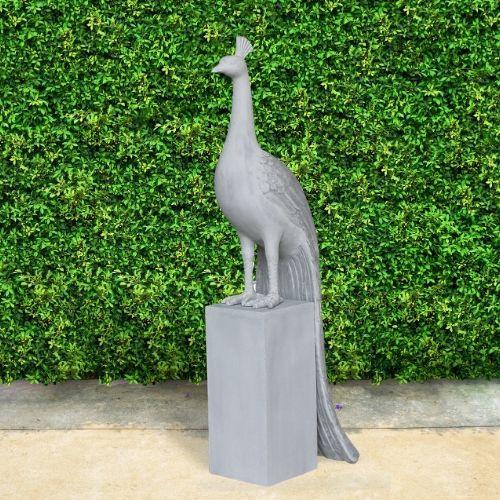 Elegant Peacock Garden Art made of lightweight cement suitable for outdoors