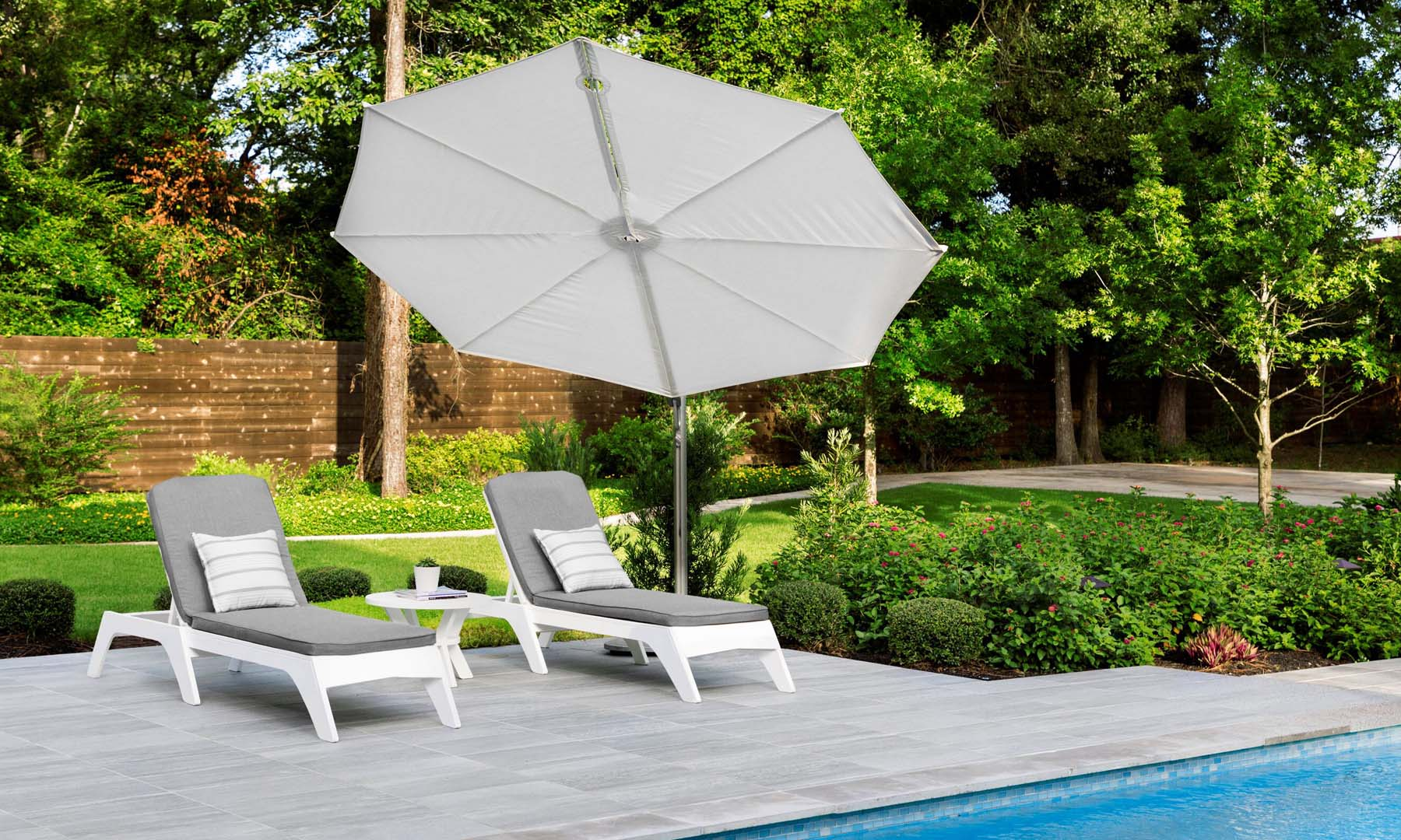 Ledge Lounger Umbrella gracing a Houston Swimming Pool