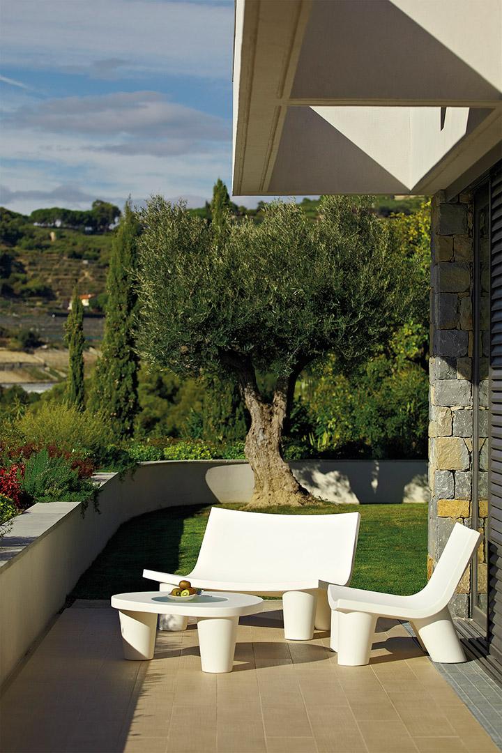 Low Lita Armchair on garden terrace
