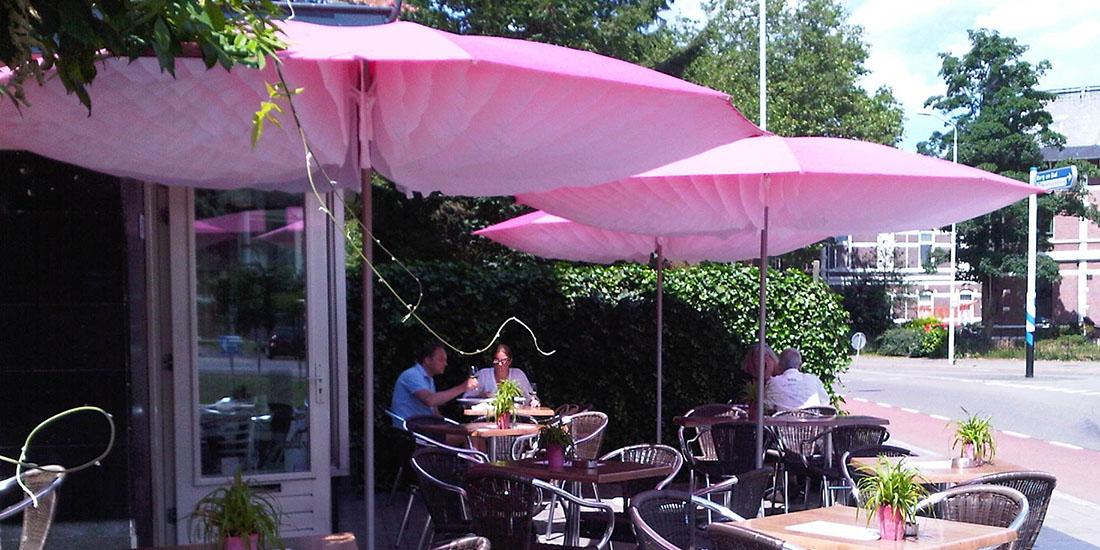 Pretty in Pink Paddo Umbrella Parasol on the terrace